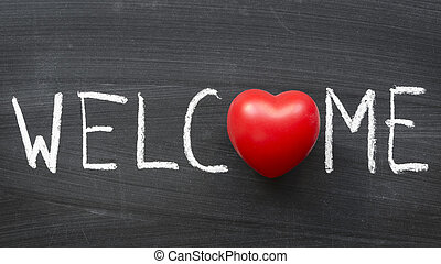 welcome word handwritten on blackboard with heart symbol...