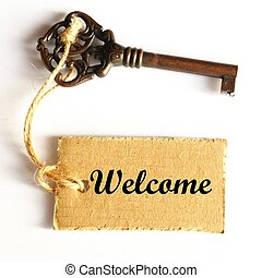 welcome concept with old grunge key and label or tag