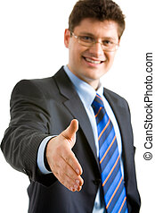 Welcome - Portrait of friendly businessman giving his hand...