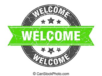 welcome round stamp with green ribbon. welcome