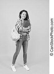 Welcome school. Pretty student back to school. Happy girl ready for school yellow background. September 1. Education and knowledge. Private teaching. Schooling. School matters