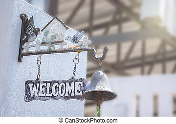 welcome sign hanging. selective focus.