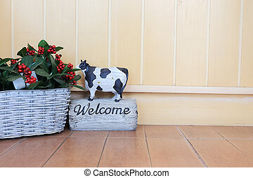 welcome sign in cafe with wood background