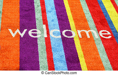 Welcome Sign In Carpet - A multi-colored carpet mat with the...