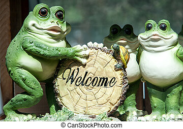 Welcome sign in the form of ceramic frogs