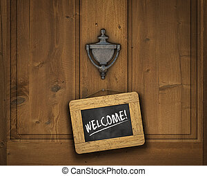 Welcome Sign - Small chalkboard hanging on a door underneath...