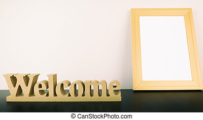 Welcome sign with blank photo frame for copy space