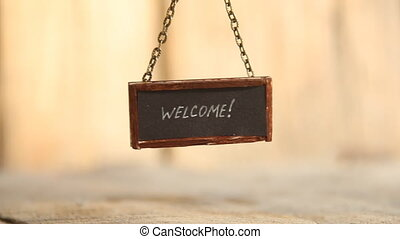 welcome text on signboard - welcome - hand lettering on...
