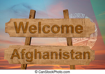 Welcome to Afghanistan sing on wood background with blending national flag