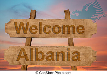Welcome to Albania sing on wood background with blending national flag