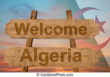 Welcome to Algeria sing on wood background with blending national flag