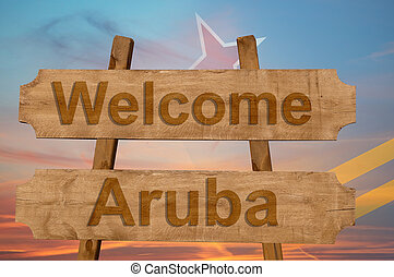 Welcome to Aruba sing on wood background with blending national flag