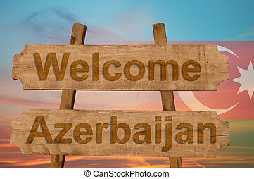 Welcome to Azerbaijan sing on wood background with blending national flag