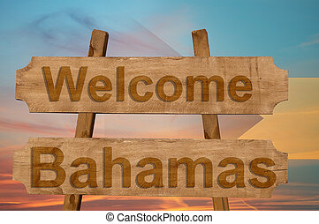 Welcome to Bahamas sing on wood background with blending national flag