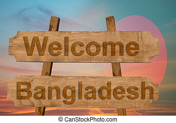 Welcome to Bangladesh sing on wood background with blending national flag