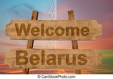 Welcome to Belarus sing on wood background with blending national flag