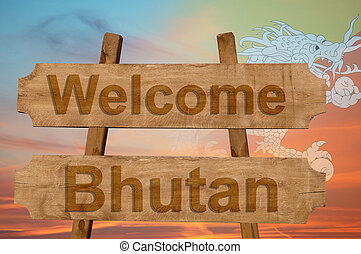 Welcome to Bhutan sing on wood background with blending national flag
