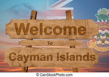 Welcome to Cayman Islands sing on wood background with blending national flag