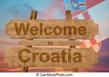 Welcome to Croatia sing on wood background with blending national flag