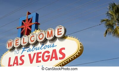 Welcome to fabulous Las Vegas retro neon sign in gambling tourist resort, USA. Iconic vintage banner as symbol of casino, games of chance, money playing and hazard betting. Lettering on signboard.