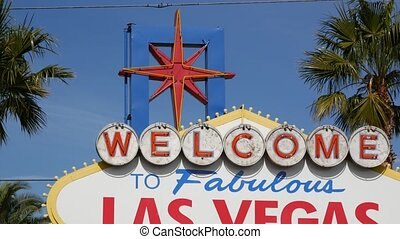 Welcome to fabulous Las Vegas retro neon sign in gambling tourist resort, USA. Iconic vintage banner as symbol of casino, games of chance, money playing and hazard betting. Lettering on signboard