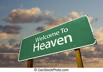 Welcome To Heaven Green Road Sign with dramatic clouds and sky.