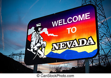 Welcome to Nevada state border sign with a sky blue...