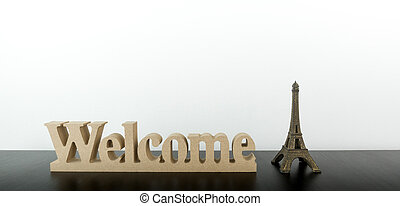 Welcome to Paris on black desk with white copy space