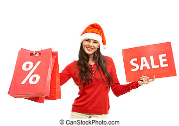 Welcome to sale - Happy girl in Santa cap holds card and...