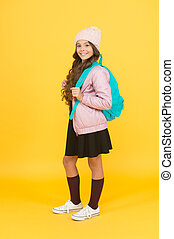 Welcome to school. Happy girl ready for school yellow background. Small child back to school in autumn. September 1. Education and schooling. Knowledge day. Learn and study. School time