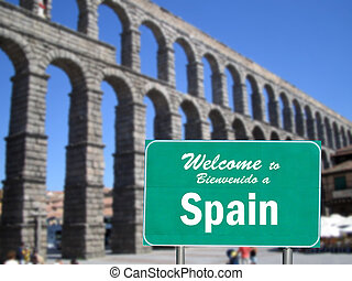 Welcome to Spain sign in front of the Stone Aqueduct in...
