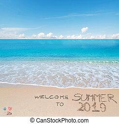 welcome to summer 2019 written on a tropical beach