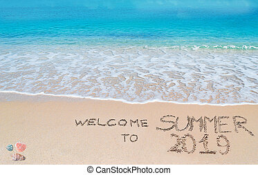 welcome to summer 2019 written on the sand