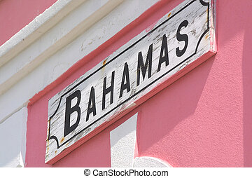 Welcome to the Bahamas - Bimini Island. A sign is wall-mounted.