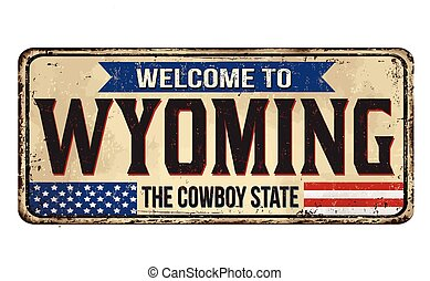 Welcome to Wyoming vintage rusty metal sign on a white ...