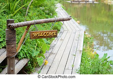 welcome wooden bridge