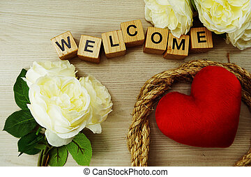 welcome wooden word text with space copy on wooden background;