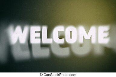 Welcome word on vintage blurred background