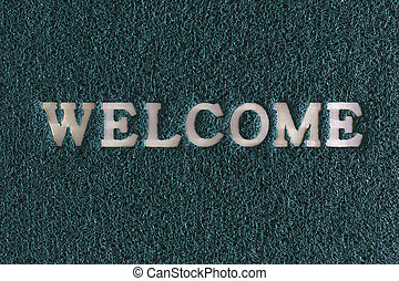 Welcome word plastic with rubber capet colorful in red green blue.