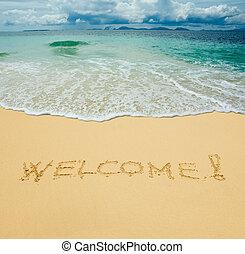 welcome written in a sandy tropical beach