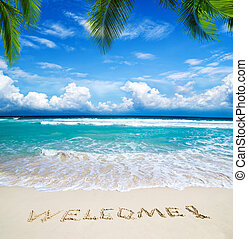 welcome written in beach - welcome written in a sandy...