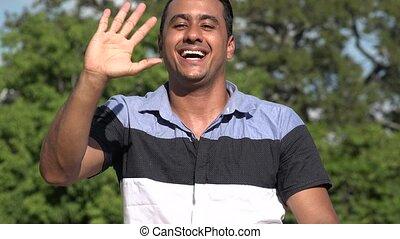 Welcoming Adult Hispanic Man Waving