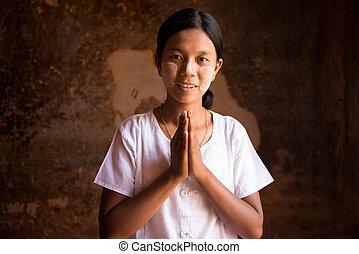 Myanmar woman in a traditional welcoming gesture