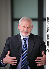 Welcoming senior businessman