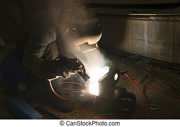 Welder and Tools on Building Site