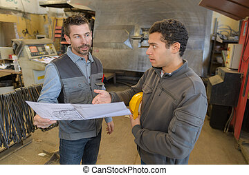 welder asking about the blueprint details