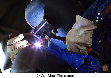 welder at factory work