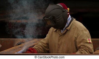 Welder at work in a industrial factory
