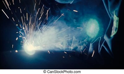 Welder at work in metal industry - Close up of welding....