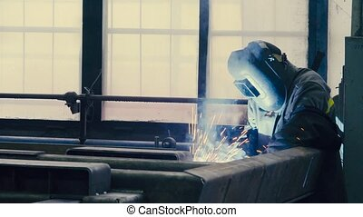 Welder at work in metal industry - Manufacture of trucks....